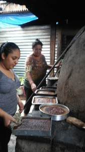 Crisol with her mother who sell cakes to earn money help with the cakes.